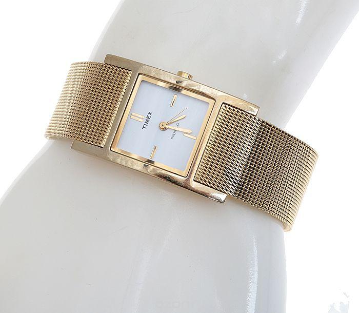 Женские наручные часы Шик от компании Timex. Кварцевый механизм. Подсветка Indiglo. Нержавеющая сталь золотого тона. Минеральное стекло. США, 2000-е годы