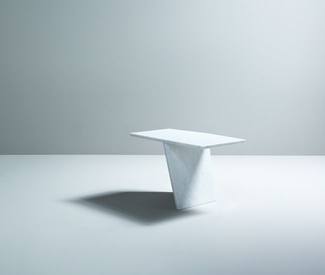 Boewer's Drift table plays with perspective. From certain angles, the Carrara marble piece's heavy top appears to be supported by a single sheet of stone.