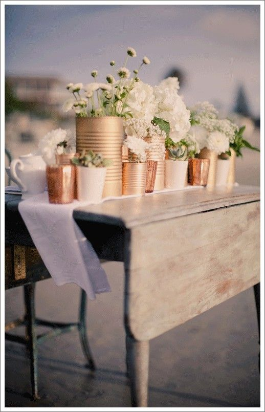 spray-painted cans. This centerpiece would be cool for a casual rehersal dinner, outdoor party, or rustic wedding. by holly
