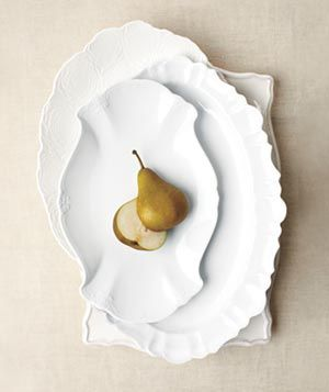 Elegant serving platters and tabletop decor from Real Simple - we like to stick to simple, clean white, so food pops!