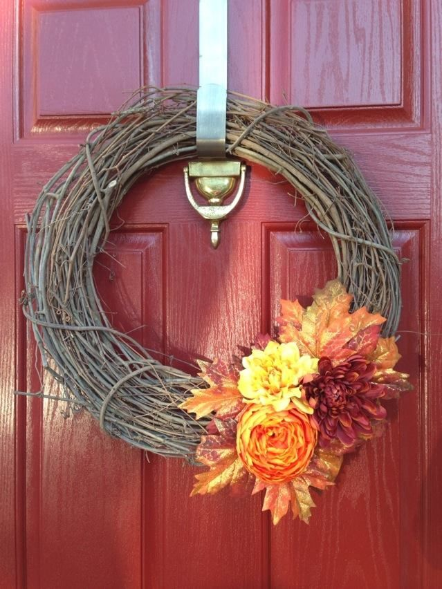 DIY Fall wreath I created. super easy. Cost about $15 to make. Just pick out whatever silk flower and leaves you like, cut off most of stems, arrange and glue onto grape vine wreath (or other type). I used clear all purpose craft glue, but hot glue would work too.