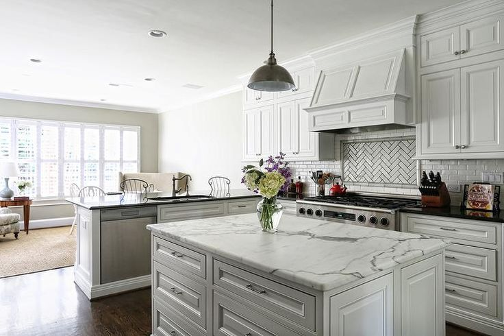 Gorgeous kitchen features white raised panel cabinets ...