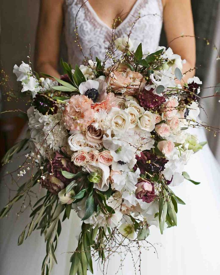 A Metallic New Year's Eve Wedding in Philly | Martha Stewart Weddings - Florist Sullivan Owen created Carrie's bouquet of olive and bay branches, spirea, peonies, Japanese lisianthus, scabiosa, sweet peas, roses, anemones, and hellebores as a surprise gift to her longtime supporter and friend.