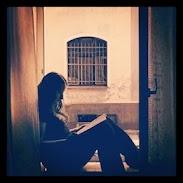 This is me sitting in a window in Pilzen, Czech Republic.
