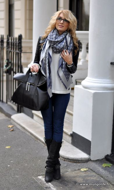 blue jeans, black boots, white/cream tee under a black jacket with Louis Vuitton scarf.
