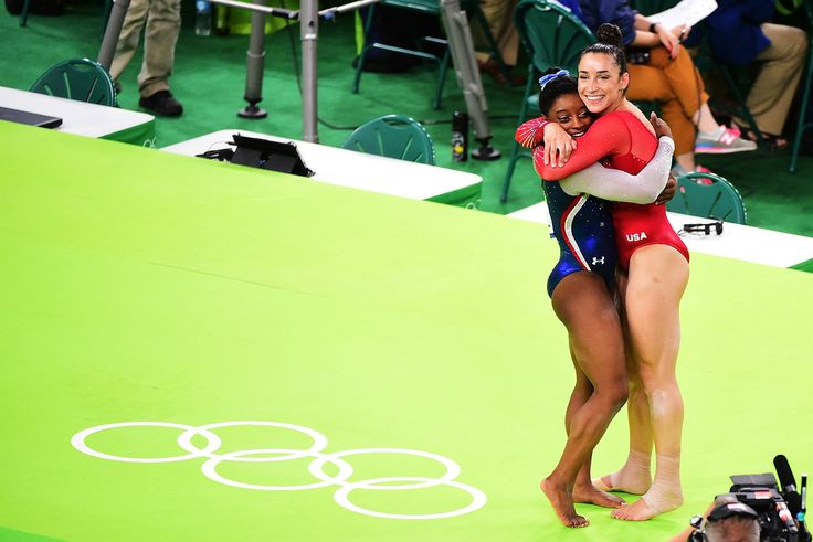 . RIO DE JANEIRO, BRAZIL - AUGUST 11:  Simone Biles (L) and Alexandra Raisman (R) of the United States celeberates after winning the gold and silver during the Women\'s Individual All Around Final on Day 6 of the 2016 Rio Olympics at Rio Olympic Arena on August 11, 2016 in Rio de Janeiro, Brazil.  (Photo by Harry How/Getty Images)