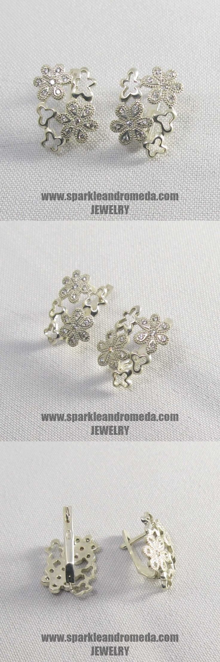Sterling 925 silver earrings with 4 round 1,5 mm and 24 round 1,25 mm white color cubic zirconia gemstones.