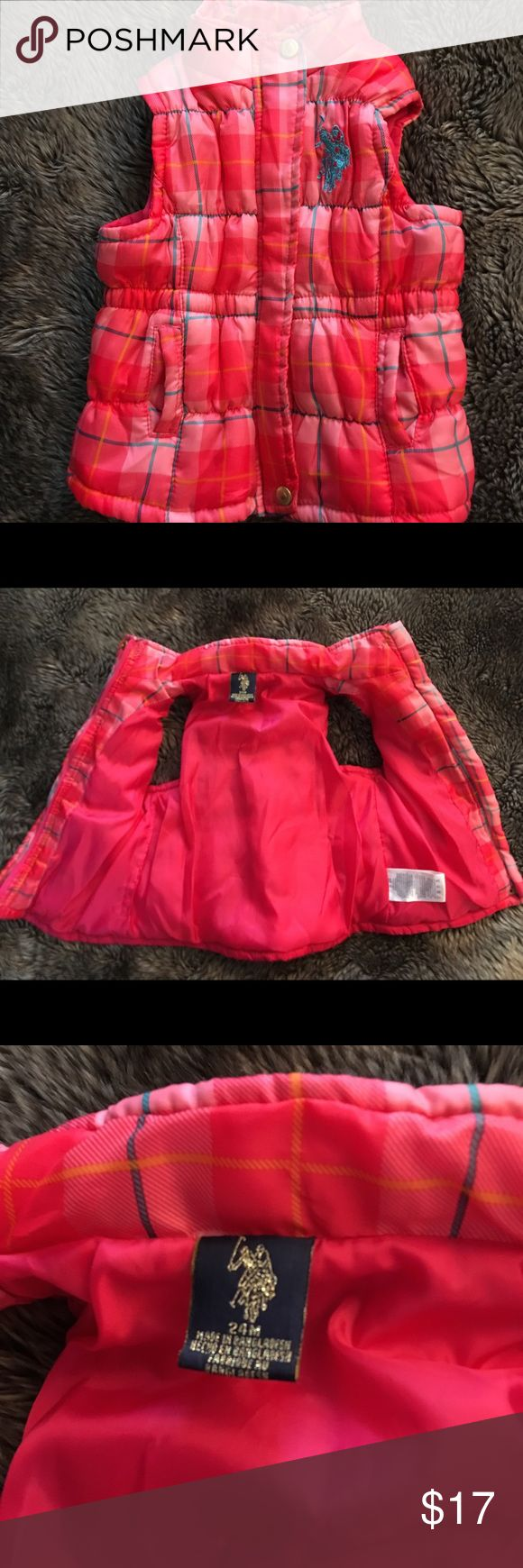 U.S. Polo association girls puff vest sz24mo U.S. Polo association girls puff vest size 24 months. Pink in color with plaid pattern. Zip up front with snap fold over. Lined inside. Fitted with elastic gathering throughout the back. U.S. Polo Assn. Jackets & Coats Vests