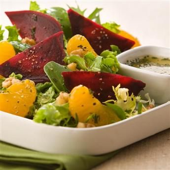 This salad combines the sweet flavor of roasted beets, mandarin oranges, lightly peppered orange dressing, and mixed greens.#recipe