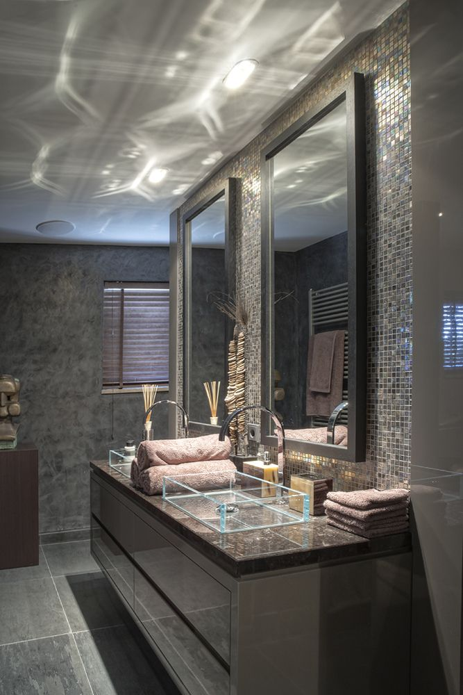 Masculine bathroom. Love the glass sinks.