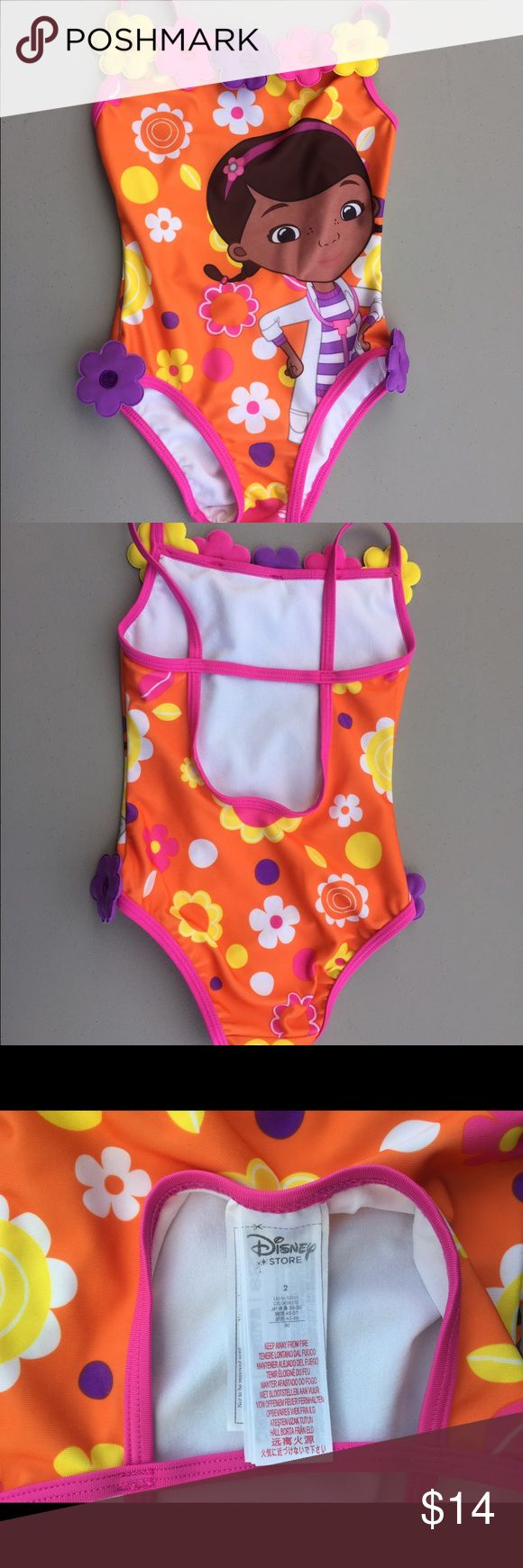 Doc McStuffins Swimsuit & Cover-up 2T Disney Store Doc McStuffins' bathing suit and hooded cover-up, size 2, good condition. Cover-up is terry cloth and has 3 faux crystal button embellishments. Disney Swim One Piece