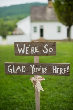 """Wedding inspirations - """"we're so glad you're here!"""" sign"""