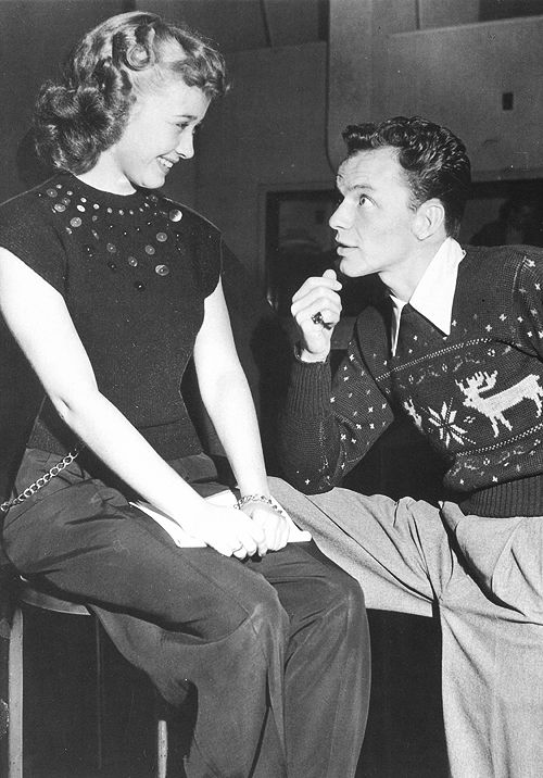 Frank Sinatra and Jane Powell on the set of Sinatra's radio show reindeer sweater men trousers pants blouse 40s fashion style print ad movie star