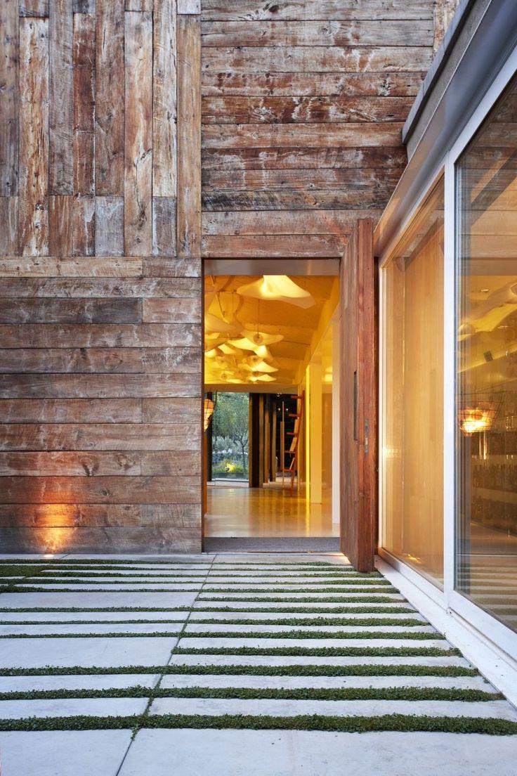 raw wood exterior blended with sleek modern landscape