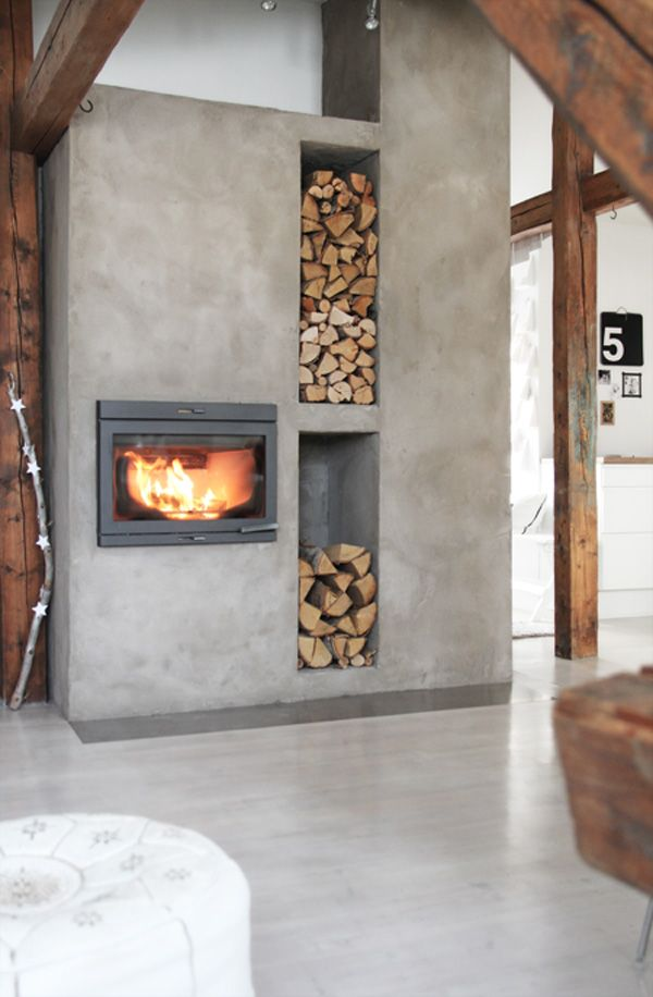 Rather than carrying wood in from outside to stock the fire, incorporate it as a design element. LOVE!
