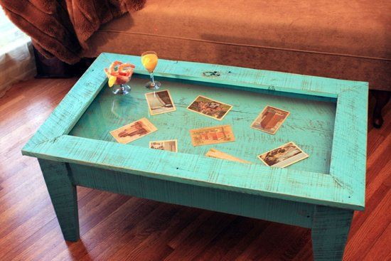 Coffee Tables: Get a coffee table with a glass tabletop and a hollowed center so you can proudly display your globe-trotting knickknacks in your living room. Finding one with cubbies can make it easier for you to organize and arrange your tchotchkes. Source: Etsy user natureinspiredcrafts