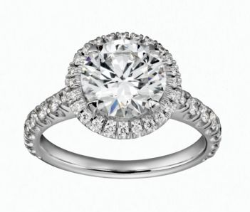 The Cartier Destinée Solitaire ring is enhanced by a halo of diamonds which bestow an exceptional radiance. This collection unfolds in harmonious curves and encapsulates the promise of a lifetime together.