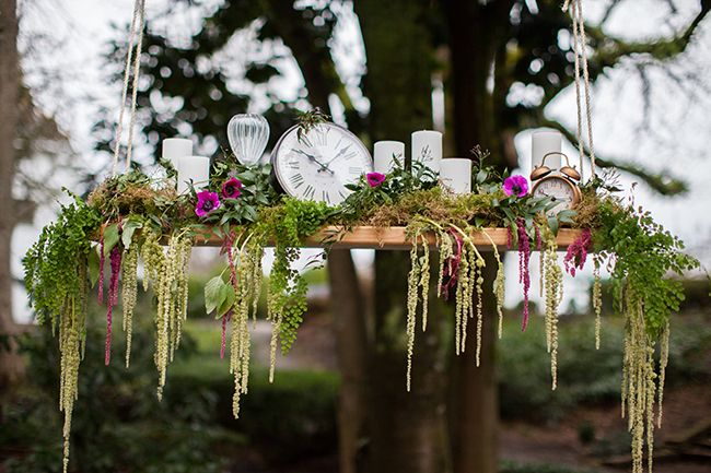 Breathtaking floral chandelier perfect for this Alice in Wonderland themed wedding.