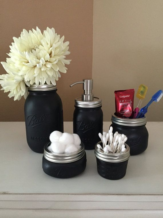 PLEASE READ FULL ITEM DESCRIPTION BEFORE PURCHASING This listing is for 5 Black Flat Paint Mason Jars. SET INCLUDES: 1 Quart Size Ball Mason Jar Vase 1 Pint Size Soap/Lotion Dispenser 1 Wide Mouth Elite Mason Jar Make-Up Brush Holder or Toothbrush Holder 1 4 oz. Mason Jar Q-Tip holder 1 Wide Mouth Ball Mason Jar Cotton Ball/Tissue Holder Mason jars are a wonderfully creative way to add a unique touch to any living space. They are wonderful as flower vases, centerpieces, or supply holders…