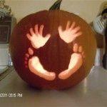 babys first halloween pumpkin idea