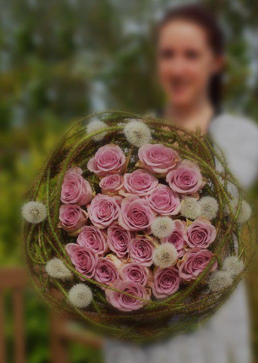 Bridal with thorny special treated rose branches and dandelion seed heads