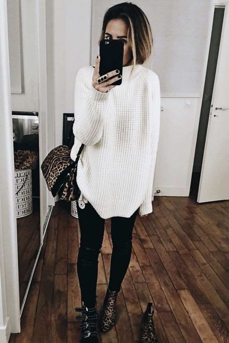 Oversized white knit sweater with black jeans.