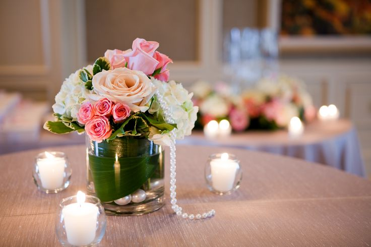 A simply elegant centre piece for a corporate ball by Dizennio Floral Boutique using pink roses, white hydrangea and luxury greens