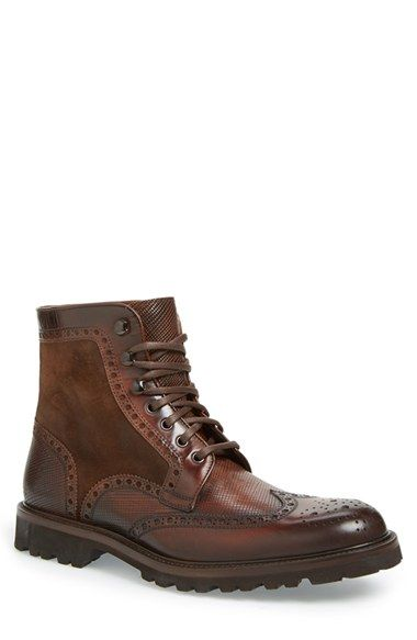 Free shipping and returns on Magnanni 'Enzo' Wingtip Boot (Men) at Nordstrom.com. Panels of etched leather add textural interest to Magnanni's burnished boot. Classic wingtip broguing and a lug sole put the finishing touches on this beautifully crafted style.