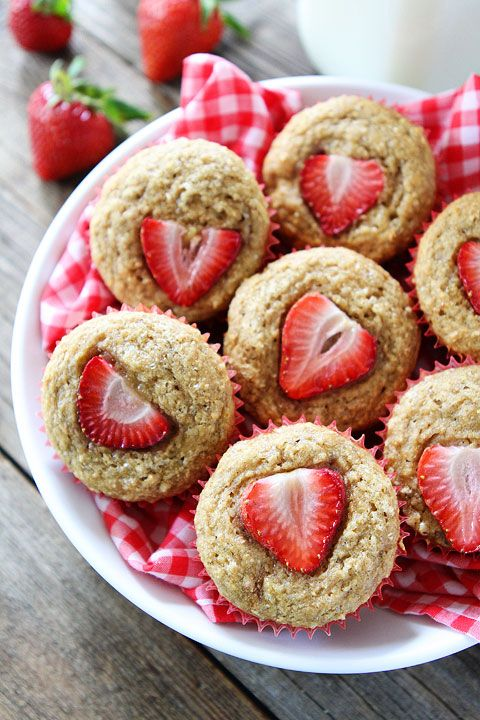 Whole Wheat Strawberry Banana Muffins Recipe on twopeasandtheirpod.com. Love these quick and easy muffins! #breakfast #muffins