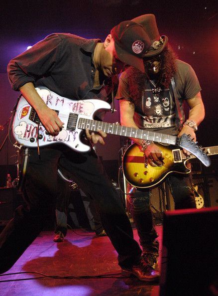 "Tom Morello with His  ""Arm The Homeless"" Mongrel Custom. and Slash with Les Paul"