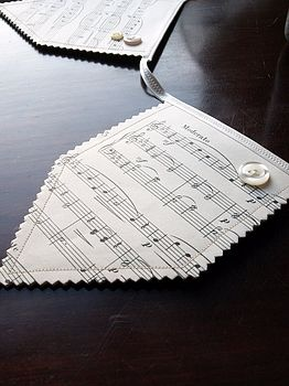 Manuscript Bunting made from pages of old sheet music, ribbon and buttons. $36 via #notonthehighstreet
