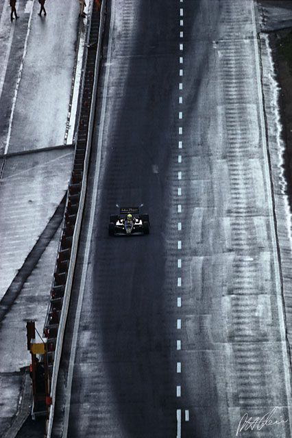 Senna, about to go up a snowy Eau Rouge in Spa 1985