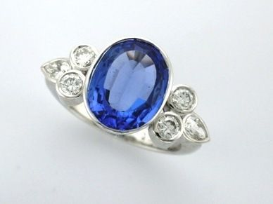 'AMANDA' --  Elegant Cocktail Ring Designed with Client's Oval Tanzanite  Bezel set with Pear & Brilliant Cut Shoulder Diamonds for a Special Birthday  Custom made in 18ct White Gold.