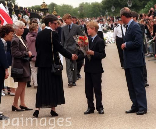 The+Prince+of+Wales+(right)+and+his+sons+Prince+William+(centre,+back)+and+Prince+Harry+(centre,+front),+receive+floral+tributes+for+their+mother,+Diana,+Princess+of+Wales,+at+Kensington+Palace.