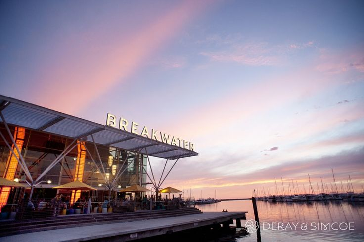 Stunning sunset at the Breakwater, perfect spot for a wedding reception by the ocean. Photography by DeRay & Simcoe