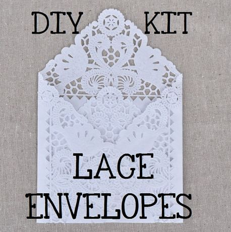 White lace invitation envelopes