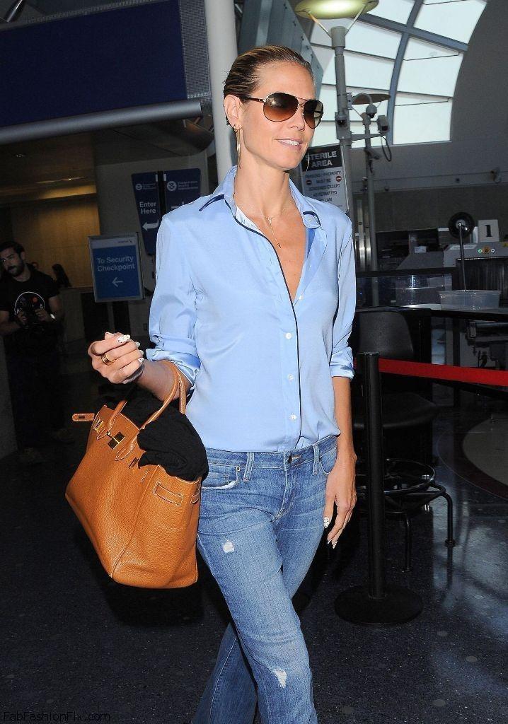 Heidi Klum street style with blue shirt, denim jeans and Hermes Birkin handbag. #heidiklum