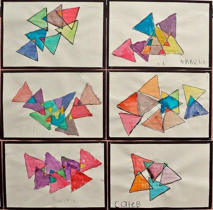 Triangle Art for First Grade: Triangles in Triangles. A first grade geometry art lesson. This was a BIG hit with my class. Thanks to Jill from Mrs. T's First Grade Class for the awesome idea! GradeONEderful.com