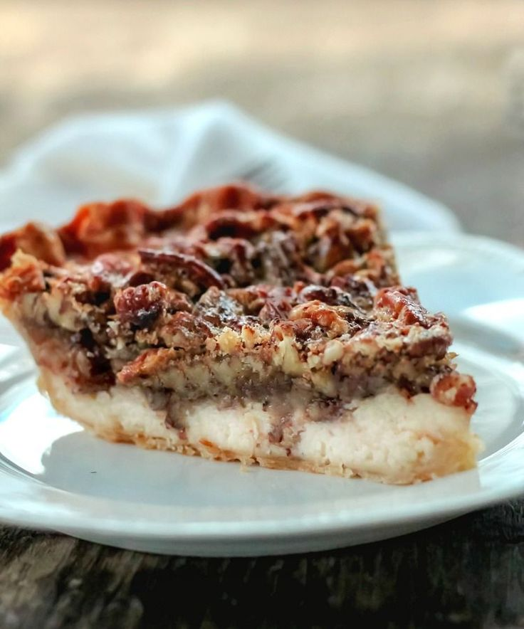 Pecan Cream Cheese Pie - With a cheese cake filling layer on the bottom and a pecan pie filling on the top, it's like having 2 pies in one.