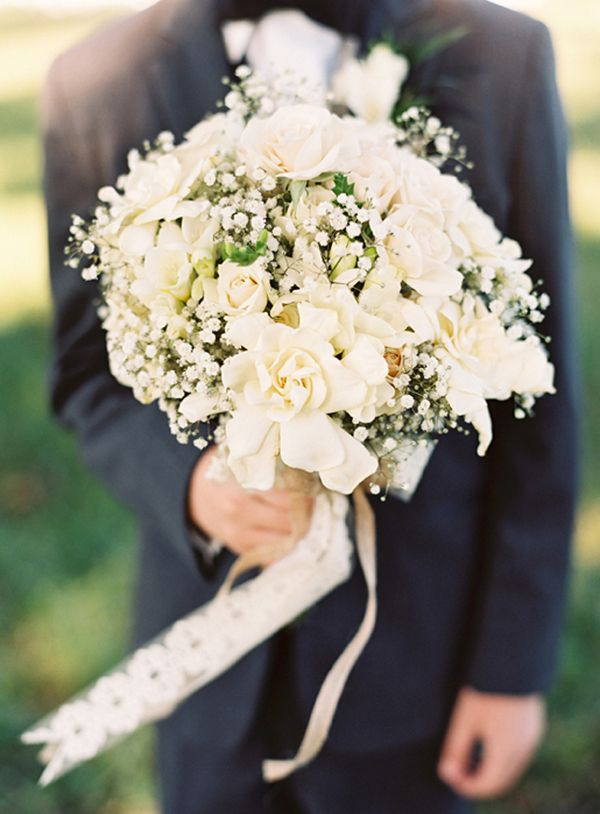 a bouquet of gardenia, white roses, and baby's breath.