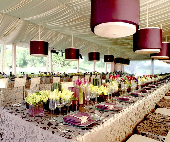 Guests were seated at two long tables lit by beautiful maroon chandeliers and natural light.