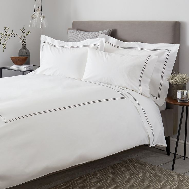 This smart collection gives our bestselling basic white bed linen a contemporary update. Made in India from crisp 200-thread-count cotton percale and detailed with two rows of hand-guided, densely stitched cording (in your choice of colour), it will give your bedroom a luxury-hotel look. Make shopping easier by stocking up on these useful sets and you'll always have a clean set of bedding waiting in the wings. Available as sets of two Oxford and housewife pillowcases, two flat sheets, two…