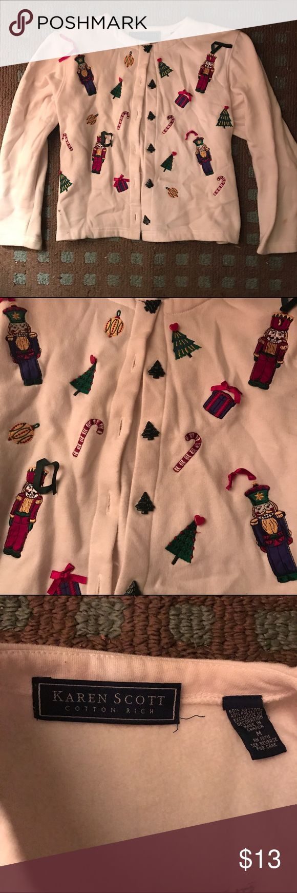 Vintage Karen Scott ugly Christmas sweater Vintage Karen Scott brand ugly Christmas sweater, only worn twice ever, once by my aunt yearssss ago and then once by me this past xmas. Has small shoulder pads and is actually quite cute on! Perfect for that ugly sweater party! Off white with decorations on front only. Buttons all the way down front are even little green xmas trees! One discoloration that I found on the sleeve from it sitting in storage, probably will wash out but I haven't…