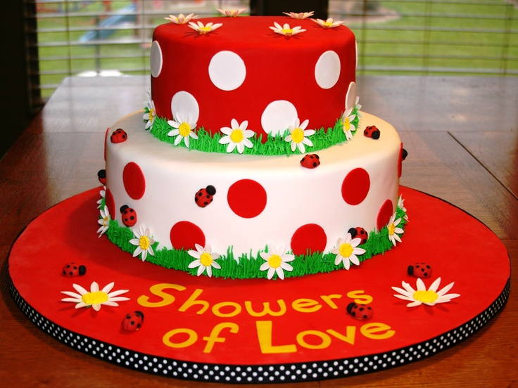 Ladybug baby shower cake - Two-tiered fondant cake w/ gumpate daisies and lady bugs.