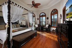 Tropical Master Bedroom with Paint1, High ceiling, Crown molding, Hardwood floors, Ceiling fan