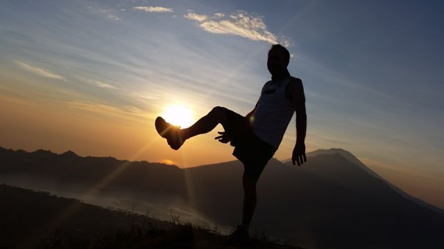"Kicking a ""sunrise goal"" at Mt Batur Bali. Winner. http://www.sharingbali.com/retreats/"