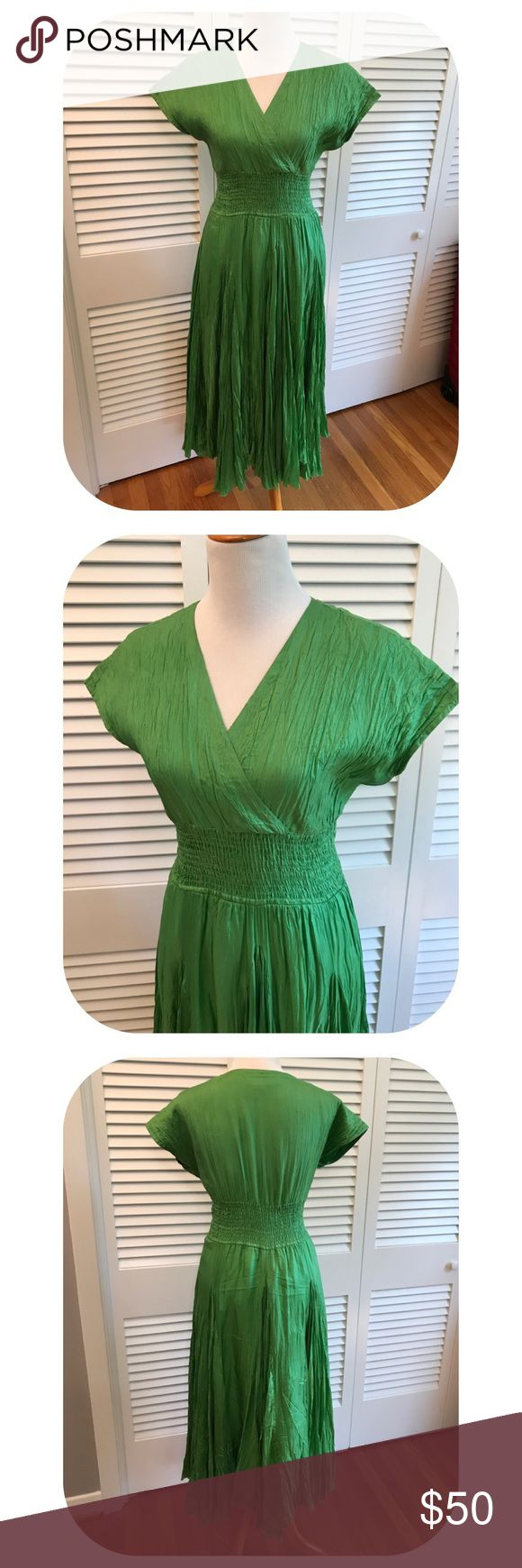 Sandy Starkman Emerald Silk Smocked Waist Dress Sandy Starkman Emerald Silk Smocked Waist Dress. Faux wrap top with a smocked waist and gored, full skirt. Dolman short sleeves. So light and comfortable! Made from emerald green crinkled silk - so, the best travel dress EVER! Wear with heels and jewelry or flip flops and a Panama hat! Size small, which Neiman Marcus lists as a 2 - 4, but I can easily wear it when I'm a size 8. Two small dark marks on the back of the right shoulder. Barely…