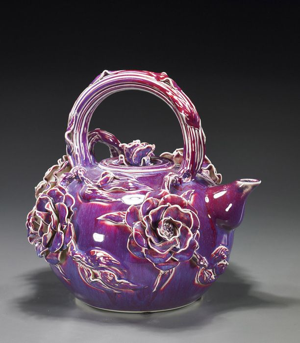 Not my favorite theme, but I like the use of one glaze that breaks over sharp edges to accentuate the flowers.