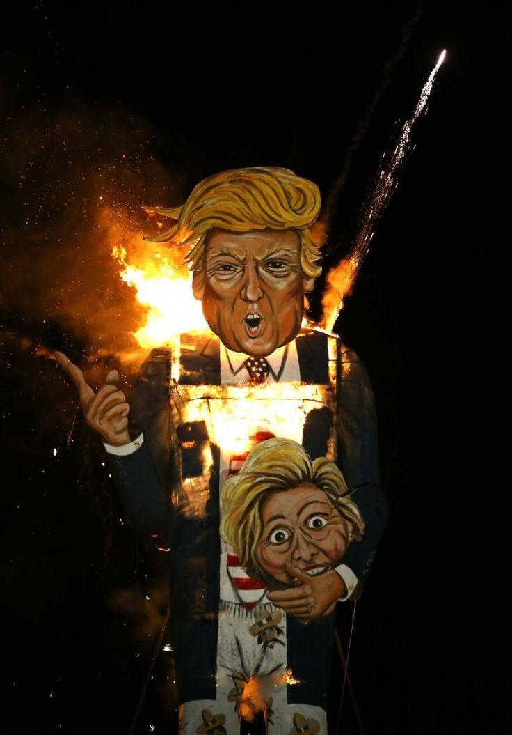 Effigy of Donald Trump carrying Hilary Clinton's Head during Bonfire Night Procession in Edenbridge, Kent.