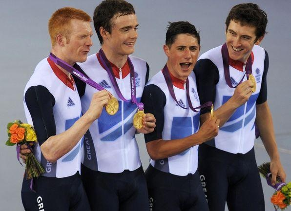 Ed Clancy, Steven Burke, Peter Kennaugh and Geraint Thomas celebrate winning Gold medals in the Men's Team Persuit